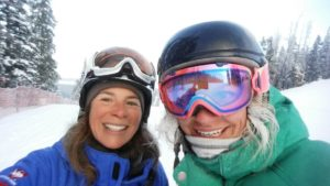 About us - Jo and Beth skiing